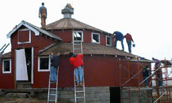 Volunteers work to restore the barn.